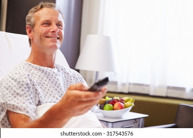 Male Patient In Hospital Bed Watching Television