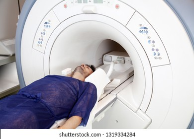 male patient laying the magnetic resonance imaging machine MRI and computed tomography at hospital.