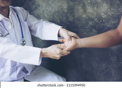 Male patient at orthopedic medical exam in hospital officeTraumatologist orthopedics surgeon doctor examining middle aged man patient to determine injury, pain, mobility and to diagnose medical treatm