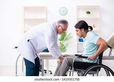 Male patient in wheel-chair visiting old doctor
