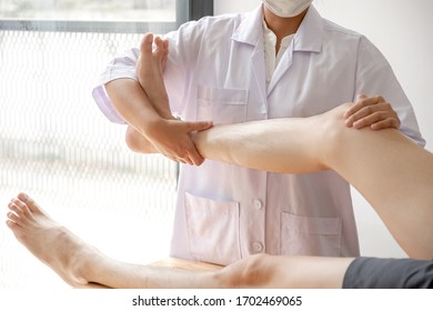 Male patients consulted physiotherapists with knee pain problems for examination and treatment. Rehabilitation physiotherapy concept.