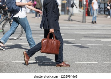 male pedestrian with brown leather bag