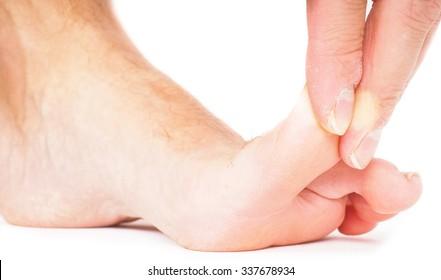 Male person pulling big toe backwards isolated towards white