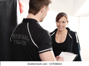 Male personal trainer with female client