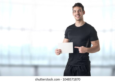 Male Personal Trainer Holding an Empty Card