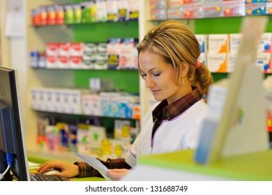 male pharmacist holding prescription