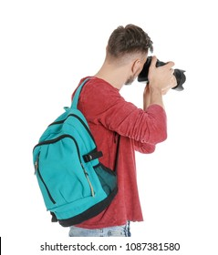 Male photographer with camera on white background