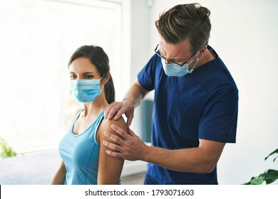 A Male Physical Therapist Stretching a Female Patient Slowly.