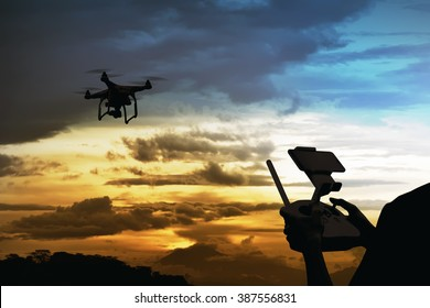Male pilot controlling drone with remote control