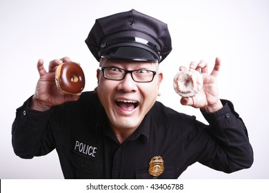 A male police officer with donuts.