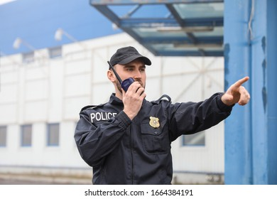 Male police officer patrolling city street