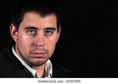 Male portrait isolated on black with room for copy space