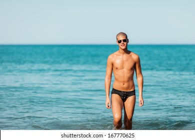 Male portrait of man posing at the beach