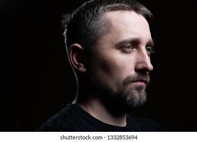 Male portrait on dark background
