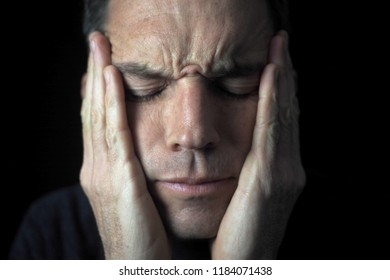 Male portrait, worried, hands on face