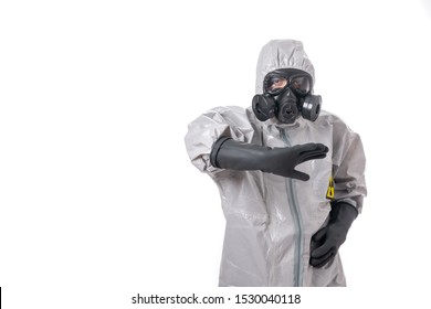 A male poses in a gray protective suit tries to protect with his hand in his elbow.Isolated background. Radiation attack