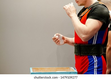 male powerlifter inhales smelling salts before you attempt in powerlifting