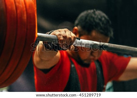 Male Powerlifter Preparing Squats Barbell During Stock Photo (Edit