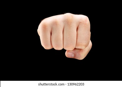 Male punch fist isolated on a black background