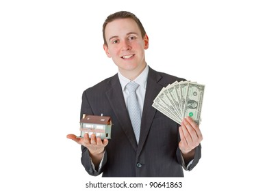 Male real estate agent with model house over white background