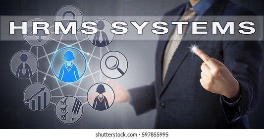 Male recruitment officer in blue shirt and suit is using HRMS SYSTEMS. Business concept and information technology metaphor for human resources management system and workforce planning.