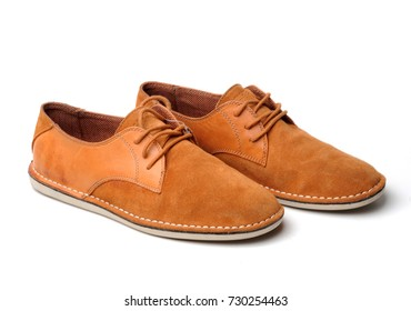 Male red leather shoes isolated on a white background. Brown leather executive shoes. Fashion still life boots.