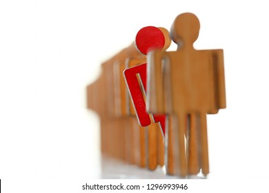 Male red plastic toy businessman silhouette wooden figure background closeup. Manipulate work recruitment transfer labour inspectorate experience exchange man hr worker subordination human concept