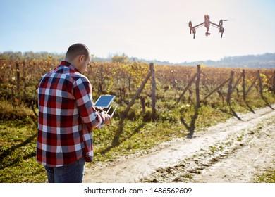 Male remote control drone on sky