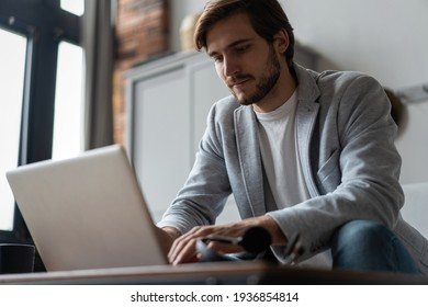 Male remote working from home and having work confrence video call.