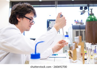 Male researcher carrying out scientific research in a lab (shallow DOF; color toned image)
