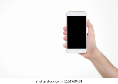 Male in right hand holding smartphone with blank screen on white background