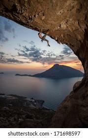 Male rock climber at sunset. Kalymnos Island, Greece