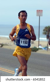 male runner competing in 10K race