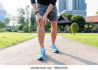 Male runner knee injury and pain