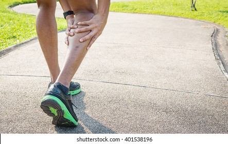 Male runner with muscle pain in right leg, Leg calf sport muscle injury