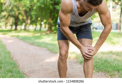 Male runner suffering with pain on sports running knee injury. Sport person often have injury.