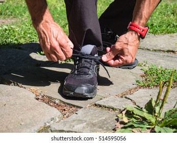 Male runner tying shoelaces