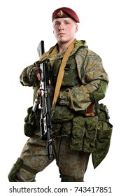 male in Russian mechanized infantry uniform (maroon beret) saluting. isolated with clipping path on white background.