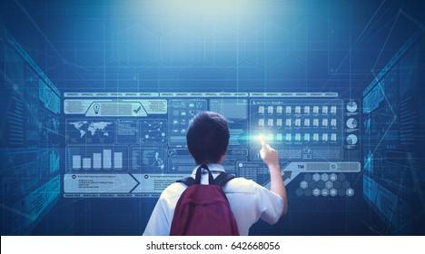 Male school boy student using virtual screen hologram technology.
