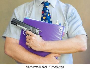 Male school teacher comes armed with a handgun to class