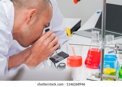 Male scientist researcher doing experiments in laboratory for development