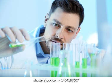 Male scientist working with sample in chemistry laboratory