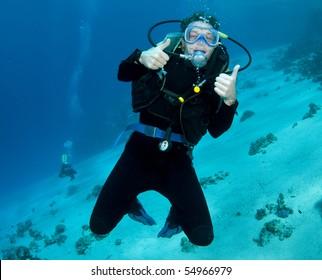 male scuba diver enjoying the dive