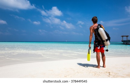 Male scuba diver looking out to the ocean