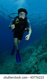 Male Scuba diver swimming on reef