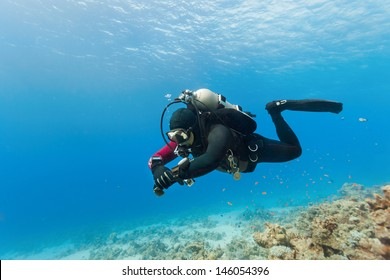 Male scuba diver swimming under water