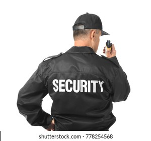 Male security guard using portable radio on white background