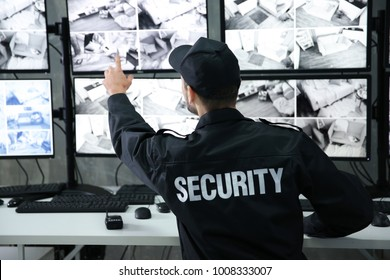 Male security guard working in surveillance room