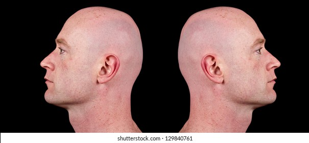 male side profile close up head shot of man male with shaved bald head. side head profile of fit man with face shaved and head shaved isolated on black. headed back to back closeup.