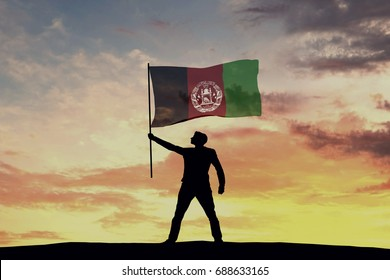 Male silhouette figure waving Afghanistan flag. 3D Rendering